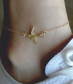 Gold swallow perfect anklet.  Not strictly tasteful but something pretty about a very fine gold chain on a tanned ankle in the summer time  R McN