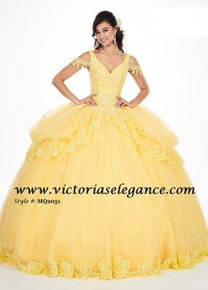 Fantasy-inspired applique and tulle gown with a V-shaped neckline, matching lace off-the-shoulder drapes and a split front pannier-style skirt. The gown finishes with a lace-up back closure, scattered appliques, and a matching tulle cape. Tulle Gown, Ball Gown Dresses, 15 Dresses, Yellow Wedding Dress, Wedding Dresses, Mary's Bridal, Belle Bridal, Beauty And The Beast Dress, Party Frocks