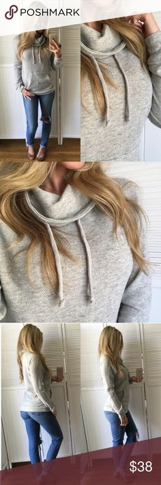 Everyday Grey Pullover *REPOSH* Simple Grey Pullover. Perfect for the Everyday Casual Day. Matches Everything. Funnel Neck, Ties to Tighten at Neck, and a Kangaroo Pocket on the Front. Terry Inside and Lightweight.   Size Medium, Never Worn Material: 55% Cotton 45% Poly Tops