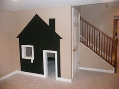 Under the Stairs Play House- this cute playhouse was done with chalkboard paint- o the kids can draw on it.