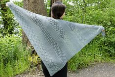 The Lattice Sampler Shawl is an asymmetric triangular shawl featuring bands of lattice lace in a Garter stitch field. Each of the lace bands is set off from the Garter stitch background by ridges of double Garter stitch. The shawl finishes with a wider band of large lattice lace.