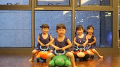 WANG IDENTICAL QUADRUPLETS:  Audrey, Emma, Natalie and Isabelle playing in gym.  The Girls were born in Stanford, California, USA.