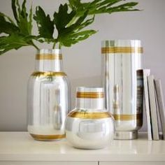 Decor/accessories - Our Mixed Metal Etched Vases are the best of both worlds, with a shiny nickel construction and a pair of bold brass stripes. Furniture Sale, Furniture Decor, Modern Furniture, Modern Wall Decor, Modern Room, Modern Living, Decorative Accessories, Home Accessories, Bookshelf Styling