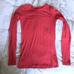 """Lululemon Long Sleeve Shirt Gently worn no holes or stains. There are a few pulled threads on the back but doesn't effect the stitching of any seams and doesn't create a hole in the fabric. See pic, barely noticeable. Smoke free home. No size tag but is an 8... 16"""" pit to pit 32"""" chest unstretched. 27"""" length. Please measure yourself and/or compare this with another lulu item to make sure this will fit you! Reasonable offers welcome as always lululemon athletica Tops Tees - Long Sleeve"""