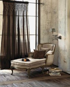 MIXING STYLES. Though this was styled for a shoot there is a lot I like. The juxtaposition of the industrial style stucco walls, the bare floor boards, the large steel framed window and the smocked curtain treatment. Of course the Louis XV style chaise longue is most inviting too. Sourced from @zsazsabellagio via Pinterest #chic #mixingstyles #eclecticdecor #interiors #interiordesign #decor #decorazio #decoracao #decoracao #decorator #decoraating #salon #chaiselongue #woodenfloors…