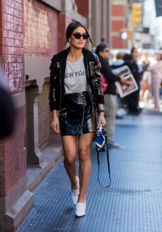 Camila Coelho wearing black jacket and skirt seen in the streets of Manhattan outside Rebecca Minkoff during New York Fashion Week on September 9...