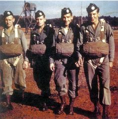 "The real Band of Brothers, from left to right: Private Carl L. Fenstermaker, Private Roderick ""Rod"" G. Strohl, Private Forrest ""Gutty"" L. Guth, and Private Amos ""Buck"" Taylor. All from Third Platoon, Easy Company, 506th Parachute Infantry Regiment (E/506), prepare for a training jump at Camp Toccoa, Georgia, in 1942 (other sources said as Camp Mackall in North Carolina)."