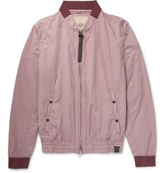 Nemen's bomber jacket is made in collaboration with design studio Finest Cloth, who use intricate textile manufacturing processes to bring garments to life. It is cut from featherweight cotton-blend shell, garment-dyed a soft pale-pink and framed with burgundy jersey trims. The oversized leather-trimmed zip pull at the front is a nice finishing touch.