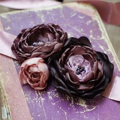 Detaching silk flowers from their stems allows you to create beautiful projects like this sash!      Get the ribbon and flowers you need at Old Time Pottery!  http://www.oldtimepottery.com/