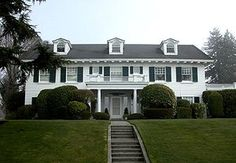 COLONIAL REVIVAL:  usually being 2 stories in height w/the ridge pole running parallel to the street, a symmetrical front facade w/an accented doorway & evenly spaced windows on either side of it. Features that make it distinguishable from colonial period houses of the similar style of the early 19th century are elaborate front doors, often with decorative crown pediments & overhead fanlights & sidelights, but w/ machine-made woodwork that had less depth & relief than earlier handmade versions.