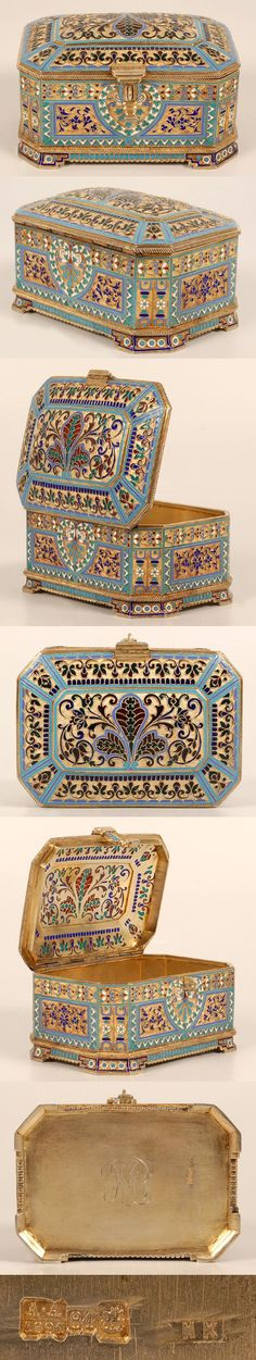 A Russian silver gilt, cloisonne and plique-a-jour enamel casket, Antip Kuzmichev, Moscow, circa 1891. The rectangular casket with shaped corners and bracket feet decorated with panels of multi-color scrolling floiate motifs within geometric borders of blue, turquoise and white enamel, the hinged chamfered lid decorated with pierced plique-a-jour enamel.