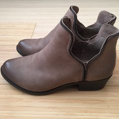 BCBG Ankle Booties Just got as a present NEVER WORN!  Too small for me . brown soft leather , detailed front in darker brown , the cut out makes this style  more then your average bootie. Small scuff on back due to packaging . SIZE 71/2 would recommend a size 7 women's  ( runs small) for Comfortable fit . 100% leather BCBGeneration Shoes Ankle Boots & Booties