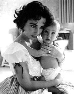 Elizabeth Taylor holding her son Christopher Wilding, 1956