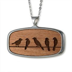 This Jay Necklace features rectangular shaped high polished pendant in stainless steel with laser etched bird motif in wood.