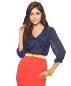 Sheer navy blouse with satin bow front.