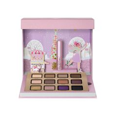 Too Faced Merry Macarons kit opens up to reveal a scene of a girl ice skating in New York City, plus a 12-shade eye-shadow palette (all of which smell like vanilla cookies) and a deluxe-sized Better Than Sex Mascara to complete the look.