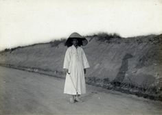 Man on a street. Early Japanese Colonial Period postcard art/photography.
