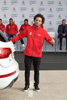 Marcelo pictured receiving his new car from Real Madrid sponsor Audi on Monday...