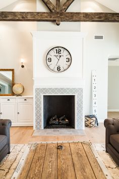 Custom interior fireplace with cement tile inlay - by Rafterhouse.