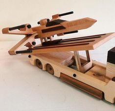 Star Wars Semi & Fighter Plane made of poplar, cedar, black walnut, pine and maple. Made by Ron Reininger in the USA. Any variation in wood should not be considered as flaws but rather the beauty of Mother Nature.