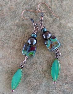 These Boho copper dangle earrings feature lovely peacock blue purple freshwater button pearls which sit above gorgeously colored Czech opaline