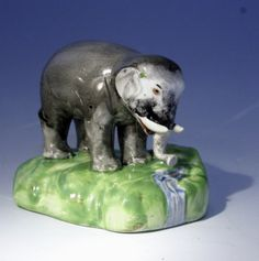 Staffordshire figure of an elephant by a stream