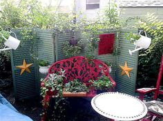 Upcycling Old Shutters in the Garden - Shut the door Shutters! 5 new ways for using funky old shutters in the garden. Using old cast off materials in nothing new to a Flea Market Gardener. Weathered shutters can be found on trash day, at yard sales and at Flea Markets or thrift stores. See what our creative crew has done with old shutters in the garden..