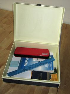 A writing box.  Great idea for keeping all writing supplies contained.  Children will enjoy having their own personalized writing kit.