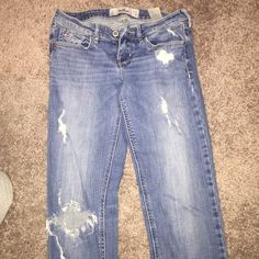Hollister Jeans Besides the hole in the knee, these are in great condition Hollister Jeans Boot Cut