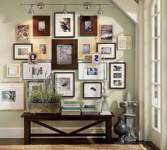 Image from http://depot88.com/wp-content/uploads/2014/11/family-photo-wall-collage-arrangements-design-in-the-corner-entryway-house-decor-with-wooden-frame-and-white-interior-color-plus-table-with-indoor-plants-and-bookshelf-ideas-975x877.jpg.