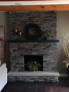 Stacked Stone Over Brick Fireplace Remodel. Quartz Hearth.