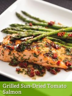"GRILLED SUN-DRIED TOMATO SALMON {LEAN}==INGREDIENTS== 6 oz raw salmon, 1-½c (18 medium 5-¼"" to 7"" spears) asparagus (1-¼ lb), ¼c fresh parsley, 2T Newman's Own® Lighten Up Sun Dried Tomato Dressing, ½T (1 piece) sun-dried tomatoes packed in oil, Dash of salt and/or pepper (opt)      ========="