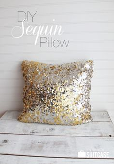 DIY Sequin Pillow. She took an old dress with a sequin skirt and fabric top and cut off the bottom skirt (but leaving an inch or so of the fabric top half still on). Then turn inside out, sew half with fabric edge to close, flip right side out and stuff a pillow inside, and hand stitch sequin edge closed. Cute!! :)