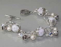 White Silver Bracelet with lampworks beads, pearls and crystals - made by myself.