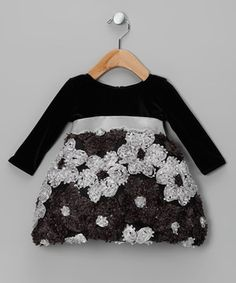 Perfect for a pretty party look, this darling dress features a velvet bodice, ribbon waist and a skirt loaded with fluffy rosettes. With lovely lining and a zippered back, this fabulous frock will dazzle on any precious princess.