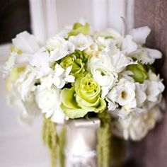 Annemarie carried a white and green gathering of roses, orchids, tulips, stephanotis and amaranthus. from the album: A Fresh Green Wedding in San Jose, CA