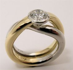 18k gold and platinum heavy wire overlap bezel set Canadian Diamond Engagement Ring. 1/2 Carat Diamond.