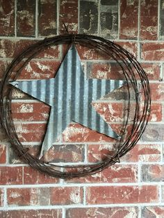Barbed wire and corrugated metal wreath