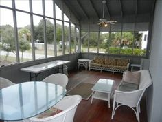 screened in patio off back of house -