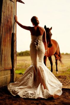 Great country barn wedding pose. Beautiful gown, too.