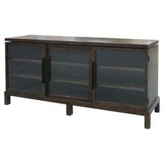 """Three-door sideboard with transparent facings and an acorn finish.  Product: SideboardConstruction Material: WoodColor: AcornFeatures: Transparent doorsDimensions: 33.75"""" H x 72.5"""" W x 17.75"""" D"""