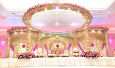 Love the open top design in addition to the lights on the under side of the horizontal beams of this mandap, allows a lot of light into the mandap. Appropriate lighting is important to me, looks nice and bright and makes for excellent photos. Wedding Reception Backdrop, Wedding Mandap, Wedding Ceremony Decorations, Wedding Themes, Wedding Designs, Wedding Venues, Wedding Set Up, Wedding Stuff, Luxury Wedding Decor