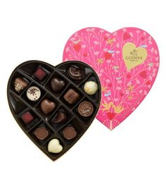 Delight your loved one this Valentine's Day with the romantic Valentine's Heart Shaped Gift Box. The fine chocolate selection includes two of our limited edition chocolate cups - the Coupe Lait Chocolat and the Coupe Noir Banane - as well as 12 Godiva favourites, including  classic white, dark and milk chocolate hearts.