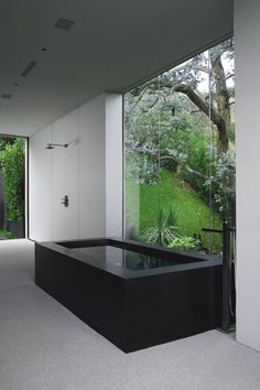 Very modern contemporary simple black bath tub! Look at the severe modern clean lines - against that huge window! What a Zen bathroom - and just think of having a shower in that open shower stall! Modern Bathtub, Modern Bathroom Design, Bathroom Interior Design, Black Bathtub, Interior Livingroom, Modern Design, Bad Inspiration, Bathroom Inspiration, Dream Bathrooms