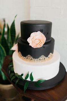 black and white wedding cake - photo by AM Weddings http://ruffledblog.com/industrial-maroon-wedding-inspiration #weddingcake #cakes