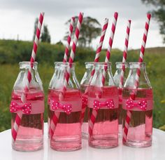 Fantastically cute pink and white polka dot bow adorned drinks. Color and flavors can be changed.Paper straws give country feel.