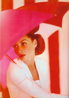 Christy Turlington and pink parasol. Ph. Javier Vallhonrat. British Vogue Feb 1992.