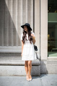 white lacy dress & black floppy hat