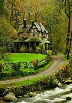 Wow! what a cool house and property. Look at the stream and trees, so pretty