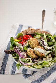 Crispy baked falafel served on a big Greek salad with creamy tahini-dill dressing